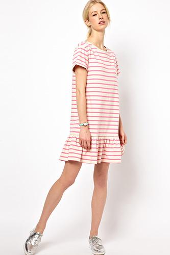 Model wearing a drop waist dress